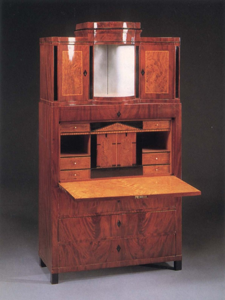 19th Century AUSTRIAN ,   Biedermeier Mahogany, Fruitwood and Burl Walnut Fall-Front Secrétaire  ,  1820-1825     Mixed woods ,  76 3/8 x 42 1/8 x 18 3/4 in. (194 x 107 x 47.6 cm)     The superstructure is fitted with a mirrored niche and flanked by two incurved cupboard doors surmounted by a stepped cornice above one frieze drawer and the fall-front opening to a fitted architectural interior centered by     BIE-001-FU